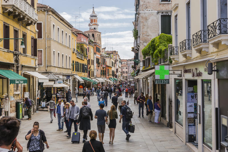 Venice in Italy. One of the many streets with tourists and shops in Venice , Italy. Europe stock images