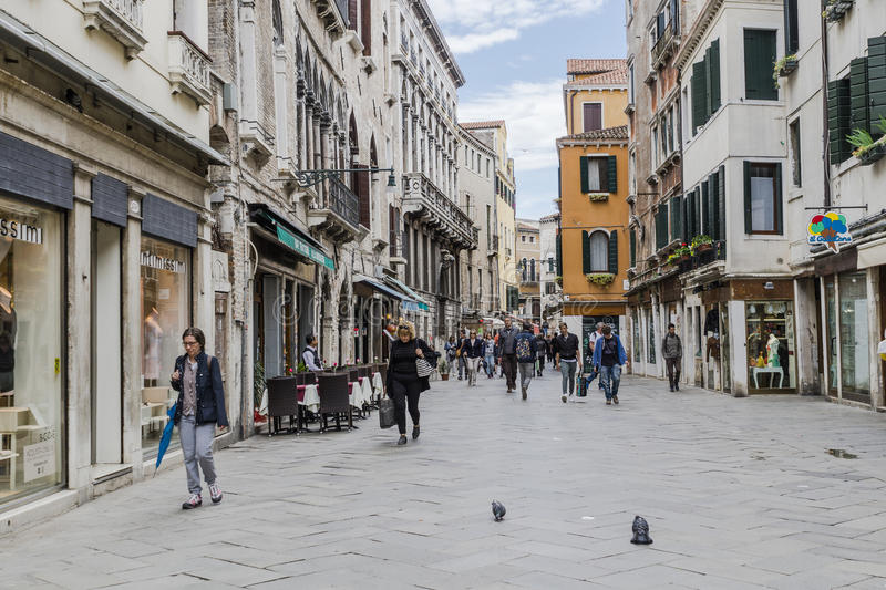 Venice in Italy. One of the many streets with tourists and shops in Venice , Italy. Europe stock photos