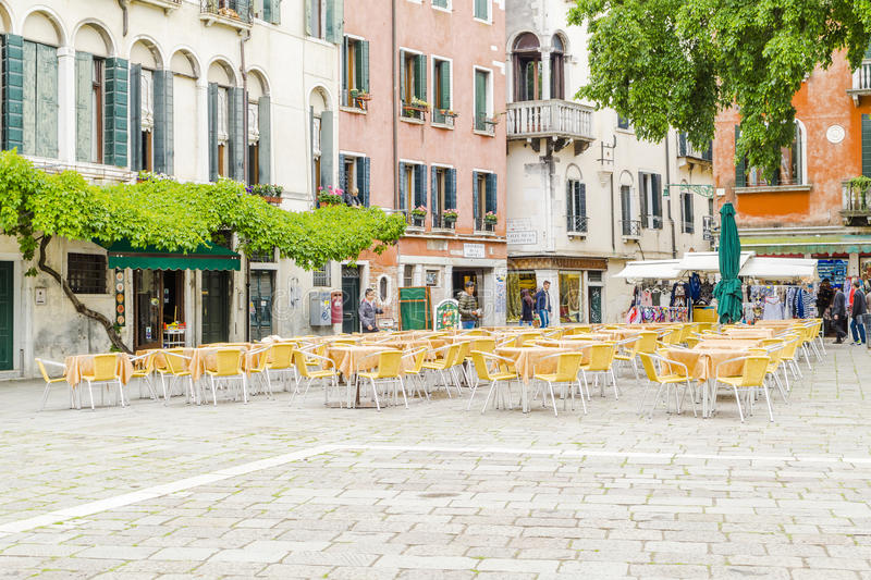 Venice in Italy. One of the many streets with tourists shops and restaurants garden in Venice , Italy. Europe stock photos