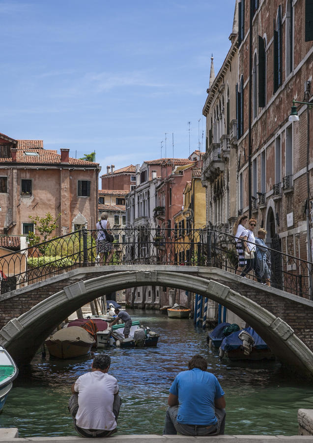 Venice, Italy - people by the canal. royalty free stock photography