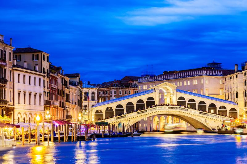 Venice, Italy. Rialto bridge and Grand Canal at twilight blue hour. Tourism and travel concept. royalty free stock photography