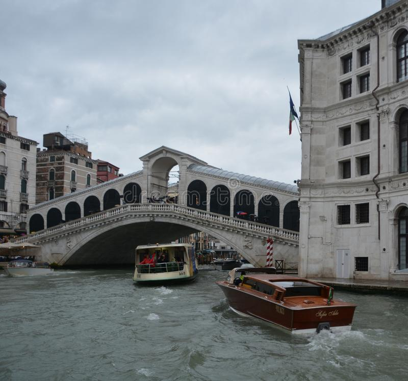 Rialto Bridge is the oldest of the four bridges spanning the Grand Canal royalty free stock photos