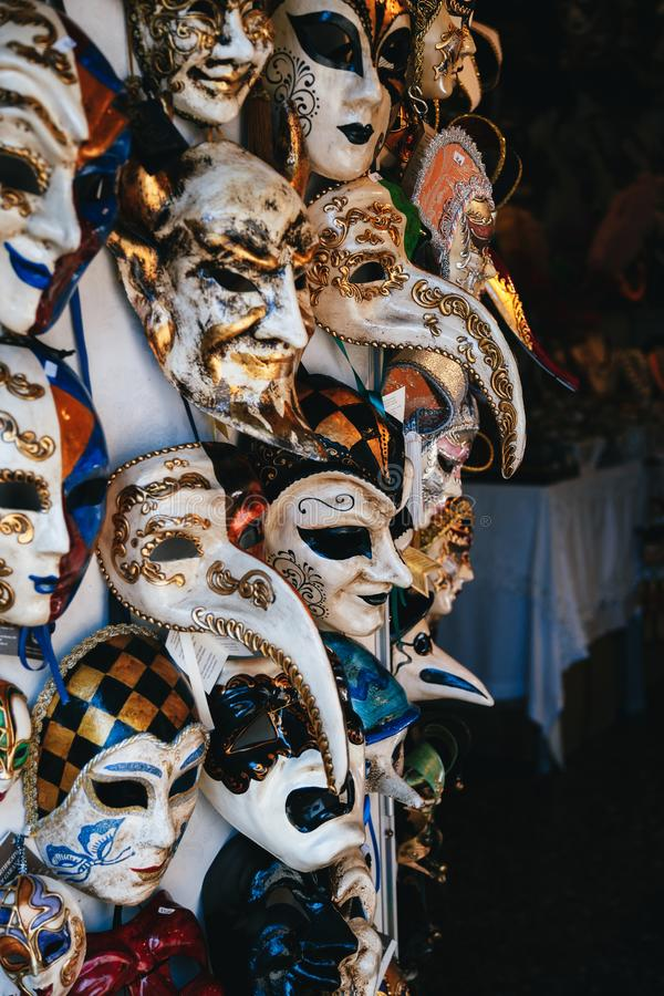 VENICE, ITALY - SEPTEMBER, 9 2018: Colorful venetian masks sale in store on street, Venice, Italy. Vintage Venetian mask stock photos