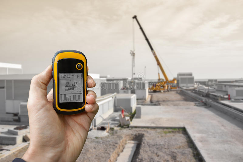 Venice, Italy - September 22, 2014: finding the right position inside a construction site via gps blurred background stock photography