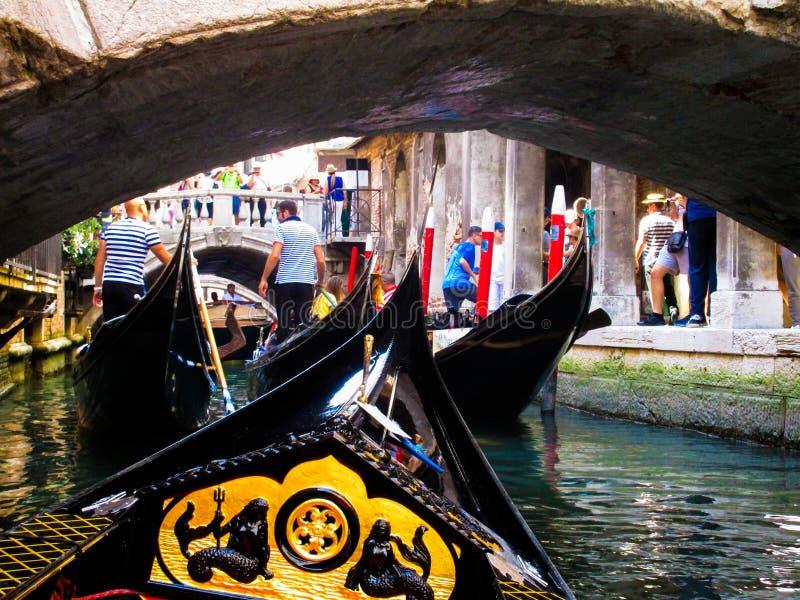 VENICE, ITALY - SEPTEMBER 19. 2018: Gondola boat trip on venetian grand and small chanels. Venice: Gondola boat trip on venetian grand and small chanels royalty free stock photography