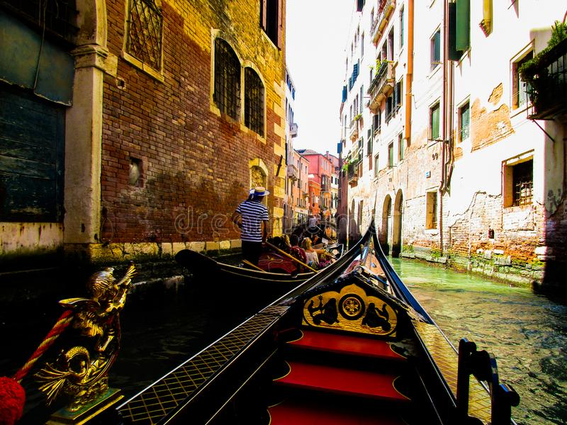 VENICE, ITALY - SEPTEMBER 19. 2018: Gondola boat trip on venetian grand and small chanels. Venice: Gondola boat trip on venetian grand and small chanels royalty free stock images
