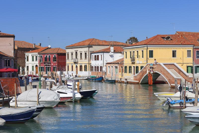 Murano island, view on the canal in the middle of the city, colorful houses, Venice, Italy stock image