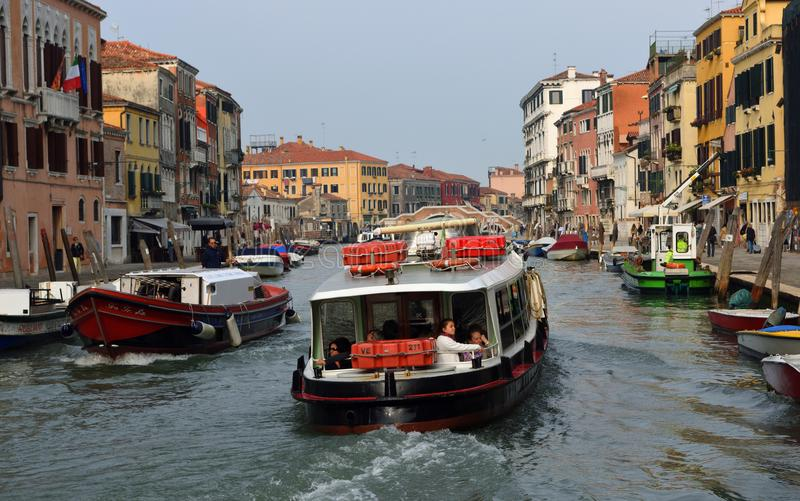 Vaporetto and other boats on the busy Cannaregio Canal , Venice Italy. royalty free stock images