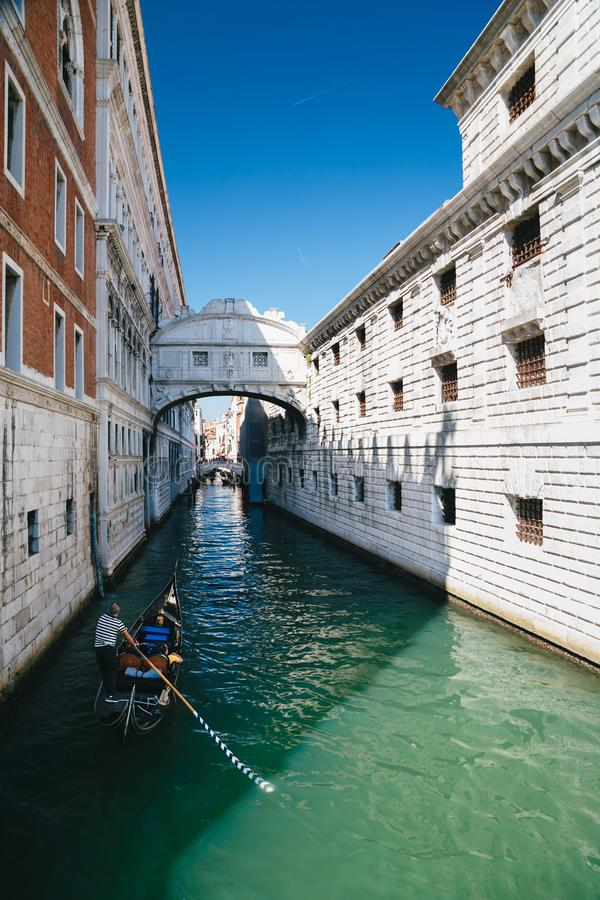 Venice, Italy - September, 9 2018: View of the famous Bridge of Sighs, a canal with gondolas at excursions in Venice, Italy royalty free stock photo