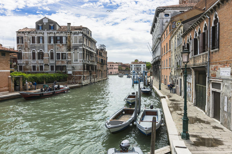 Venice in Italy. Small canal with the boats in Venice , Italy , Europe royalty free stock images