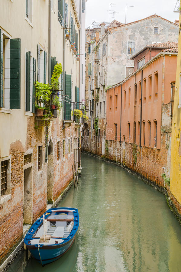 Venice in Italy. Small canal with boats in Venice , Italy , Europe royalty free stock image