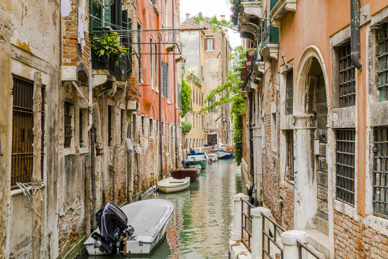 Venice in Italy. Small canal with boats in Venice , Italy , Europe royalty free stock photo