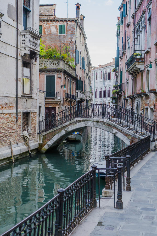 Venice in Italy. Small canal and the bridge in Venice , Italy , Europe. view from the bank stock photos