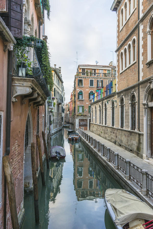 Venice in Italy. Small canal with motorboats watertaxi in Venice , Italy , Europe royalty free stock photography