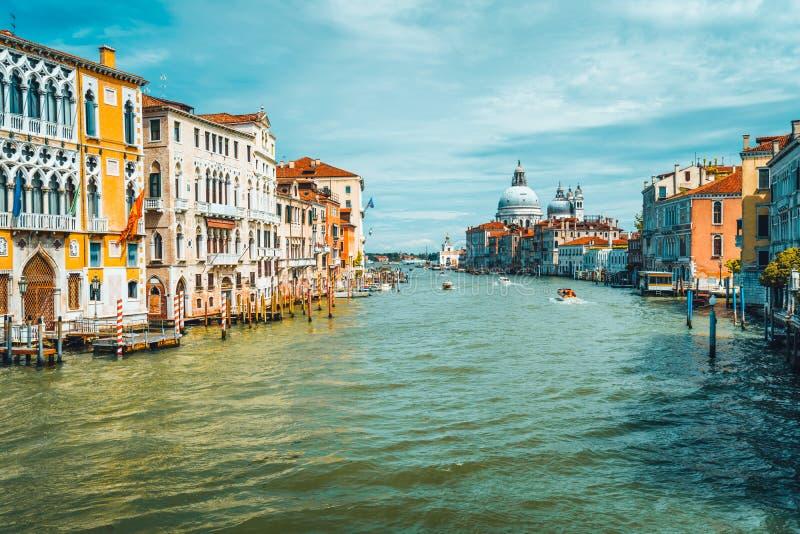 Venice, Italy. Spring season trip on Grand Canal and Basilica Santa Maria della Salute at sunny day.  royalty free stock photography