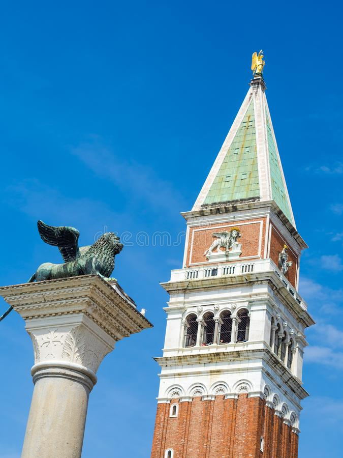 Venice, Italy, St. Mark`s Square Piazza San Marco detail of Column of the Lion and Bell Tower of Saint Mark. Campanile di San Marco stock image