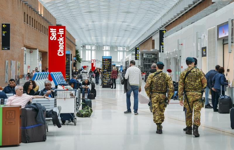Italian army soldiers patrol the passenger hall at Marco Polo International Airport in Venice stock images