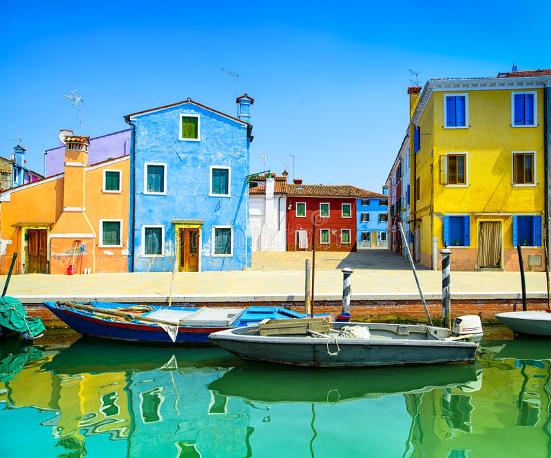 Venice landmark, Burano island canal, colorful houses and boats, Italy royalty free stock photography