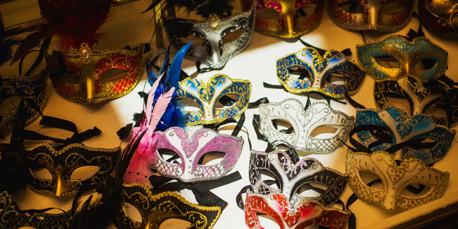 Venice mask. Colored venetian masks on a shop window. Carnival in Venice. Tourism in Italy. Celebration atmosphere. Festive. Background. Style and fashion stock image