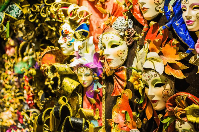 Venice mask. Colored venetian masks on a shop window. Carnival in Venice. Tourism in Italy. Celebration atmosphere. Festive. Background. Style and fashion royalty free stock photo