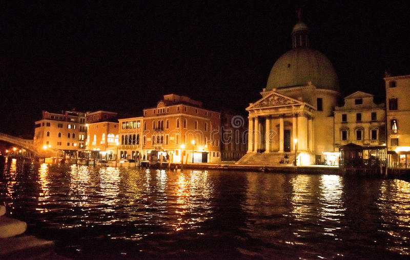 Venice at night. Venice is one of the most famous cities in Italy. It`s always full of tourists. The symbol of the city is the mask. There are numerous shops stock photography