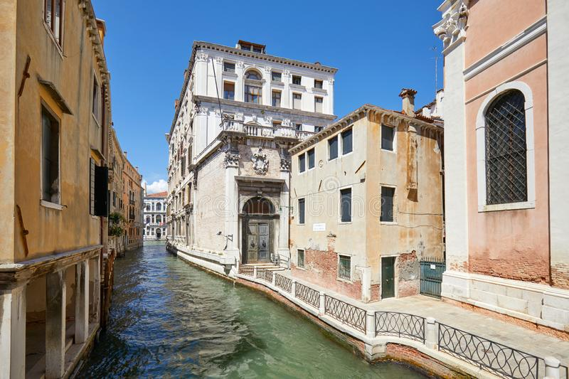 Venice, nobody in the canal and in the street in Italy. Venice, nobody in the canal and in the street, ancient buildings in a sunny summer day in Italy stock photo