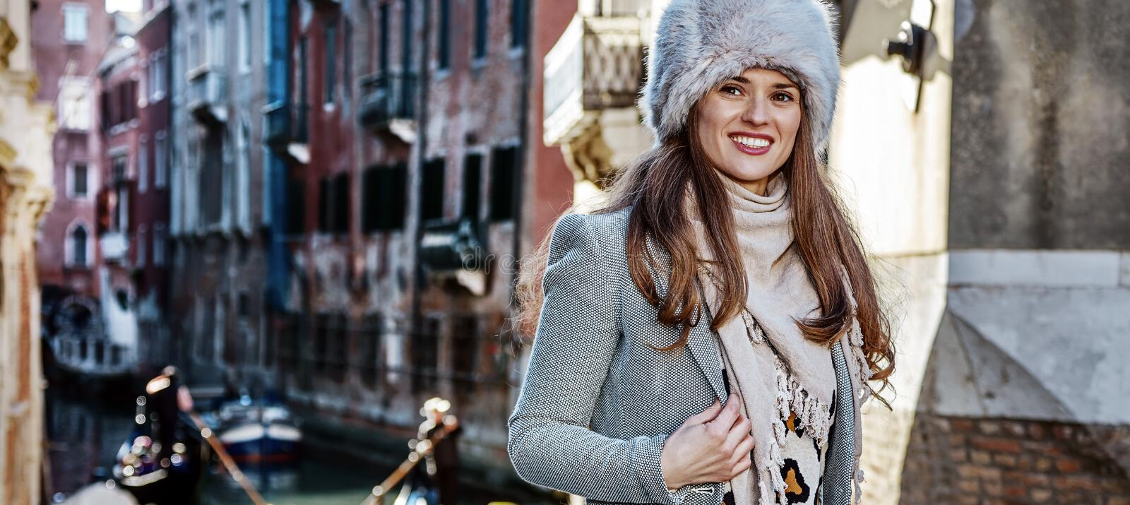 Traveller woman in Venice, Italy looking into the distance. Venice. Off the Beaten Path. happy trendy traveller woman in fur hat in Venice, Italy in the winter royalty free stock photos