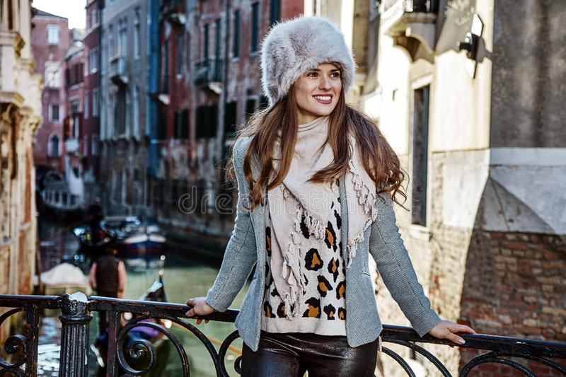Traveller woman in Venice, Italy looking into the distance. Venice. Off the Beaten Path. smiling trendy traveller woman in fur hat in Venice, Italy in the winter royalty free stock images