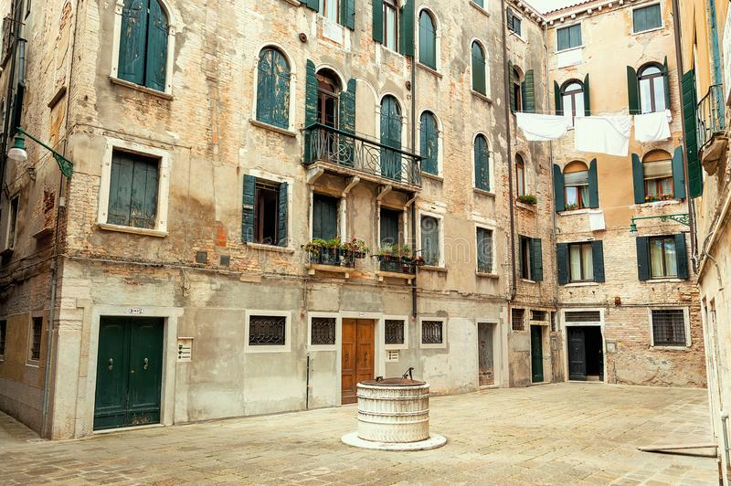 Little square in the medieval center of Venice stock images