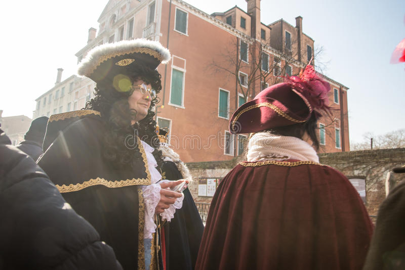Venice. Is one of the most famous cities in Italy. It`s always full of tourists. The symbol of the city is the mask. There are numerous shops selling colorful royalty free stock photography