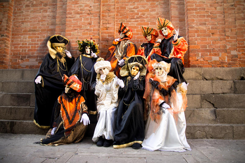 People in costumes on Carnival in Venice. Venice is one of the most famous cities in Italy. It`s always full of tourists. The symbol of the city is the mask stock images