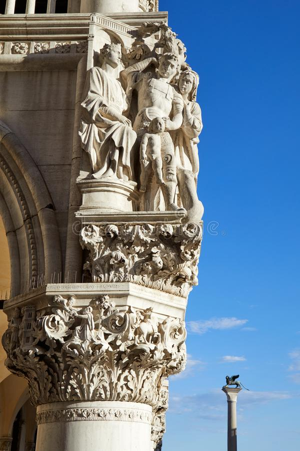 Venice, palace with white ancient sculptures and capital in Italy. Venice, palace with white ancient sculptures and capital, blue sky and sunlight in Italy stock photography