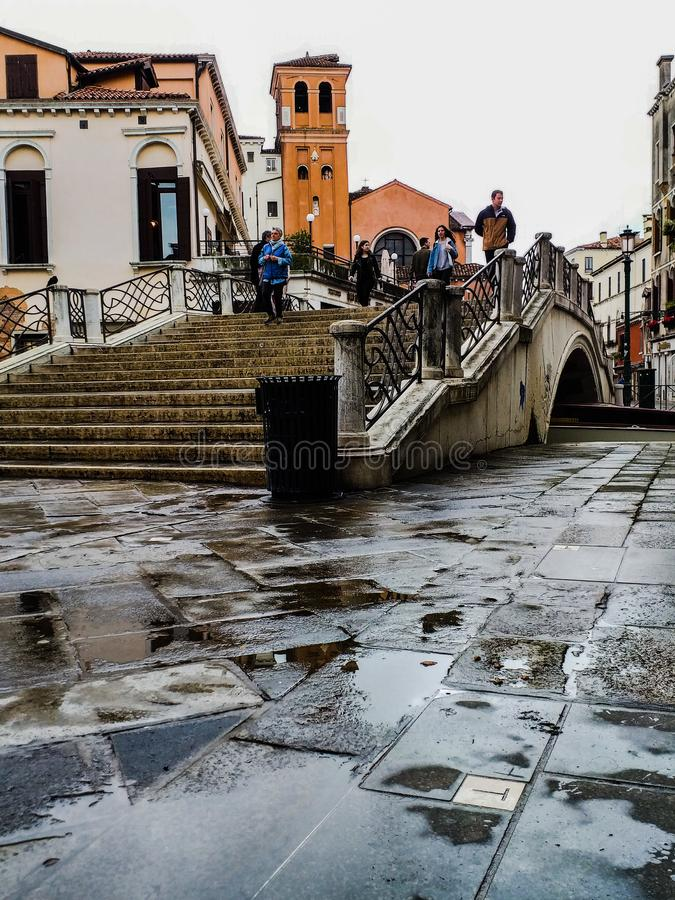 Venice. photos taken during a rainy day near the train station. images colored by the color of the wet walls that accentuate the stock photo