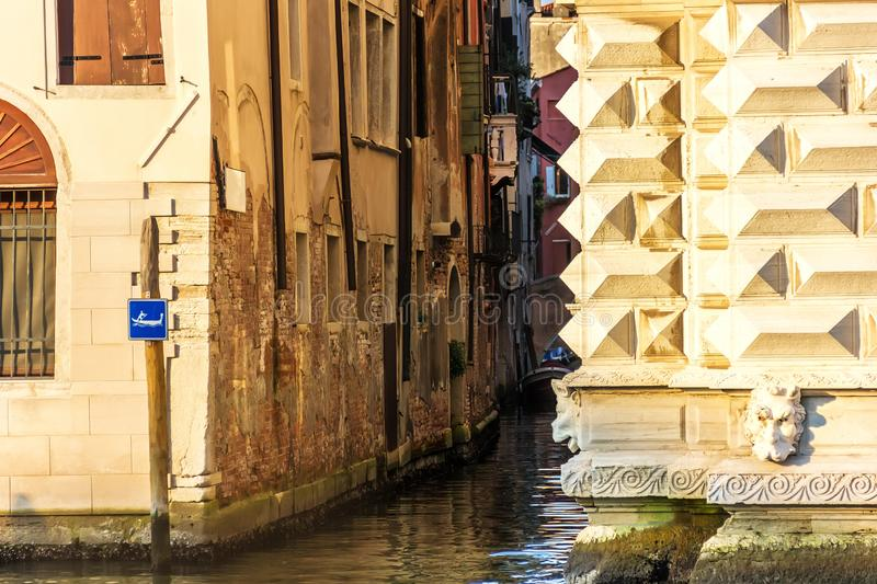 Venice rio, a typical narrow venetian canal between buildings royalty free stock photo