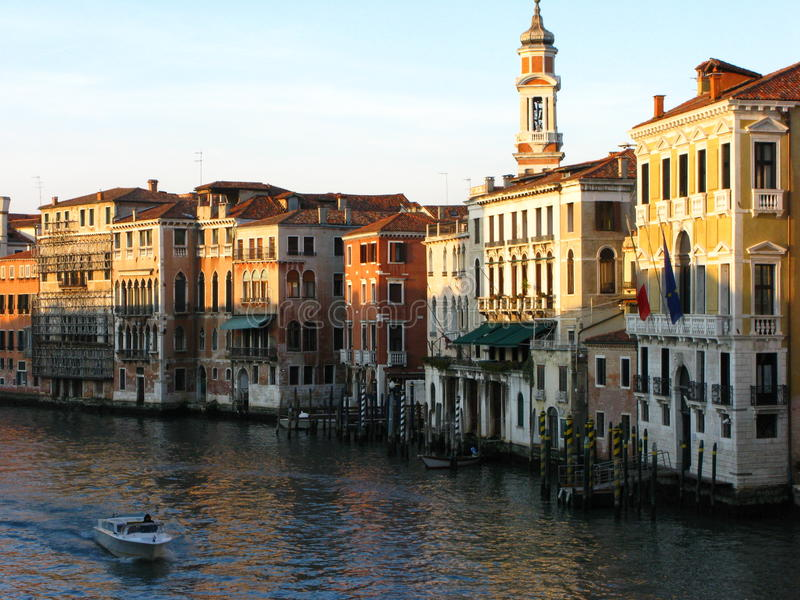 Venice river in sunset. Venice canal and boat in sunset stock photo