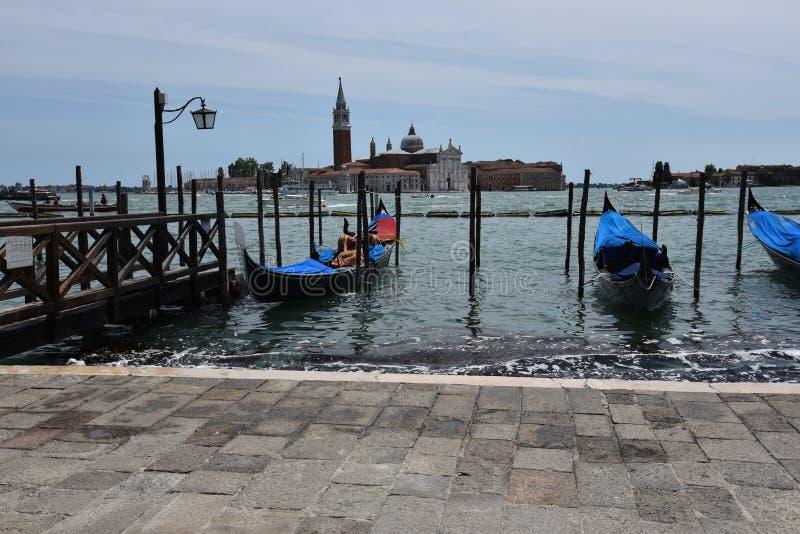 Venice`s gondolas waiting for tourists stock images