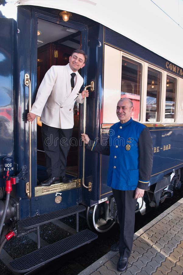 The Venice Simplon-Orient-Express - Conductors. Conductors of The Orient Express (Venice-Simplon Orient Express ) ready for departure. Innsbruck Austria APRIL 15 stock images