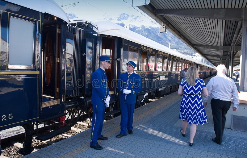 The Venice Simplon-Orient-Express - Conductors. Conductors of The Orient Express (Venice-Simplon Orient Express ) ready for departure. Innsbruck Austria APRIL 15 royalty free stock photography