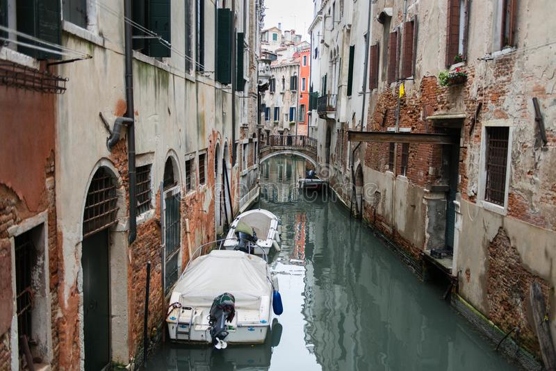 Venice is a special town on the sea in Italy. Small romantic canal, old buildings and traditional venetian houses stock photo