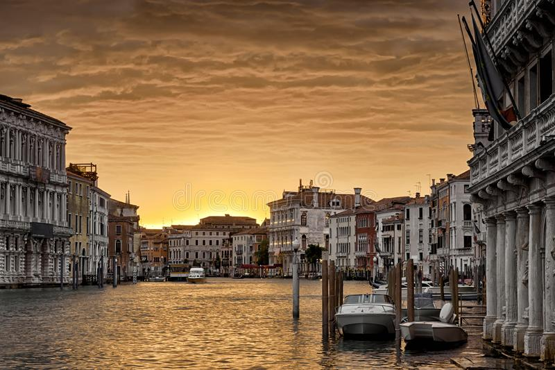 Venice at sunset, Italy. Nice view of the Grand Canal in twilight. Venice cityscape in evening golden light. Panorama of Venice waterfront at dusk. Beautiful royalty free stock photography