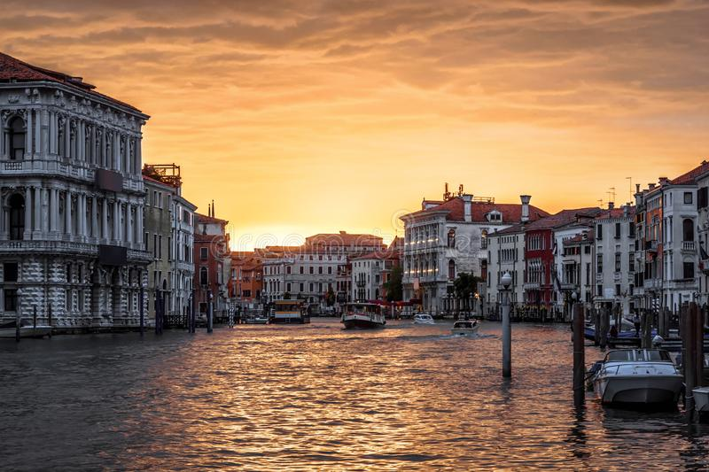 Venice at sunset, Italy. Panorama of Grand Canal in evening. Urban landscape of Venice in sun light. Beautiful sunny view of the Venice city at dusk. Romantic royalty free stock images