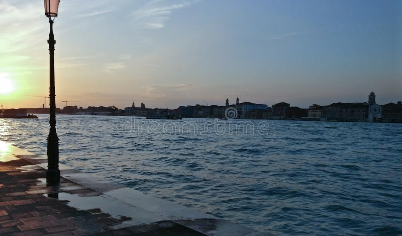 Venice sunset. By the side of the canal by the cool water royalty free stock photos