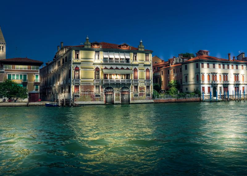 Venice twilight view on empty Grand canal and houses with light. Italy stock image