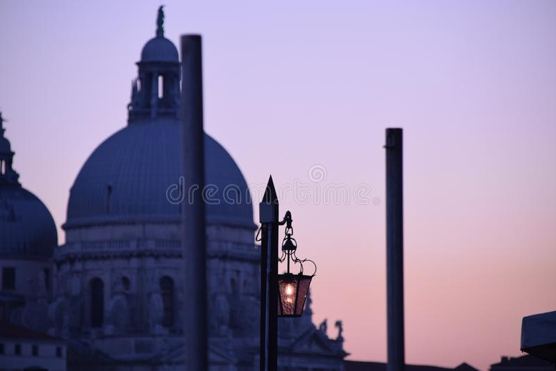PANORAMA DI VENEZIA DALLA TORRE DI SAN MARCO. Venice, Veneto, Italy - 10/31/2018: Panoramic view of Venice from the San Marco tower. It is the sunset and the red stock photos