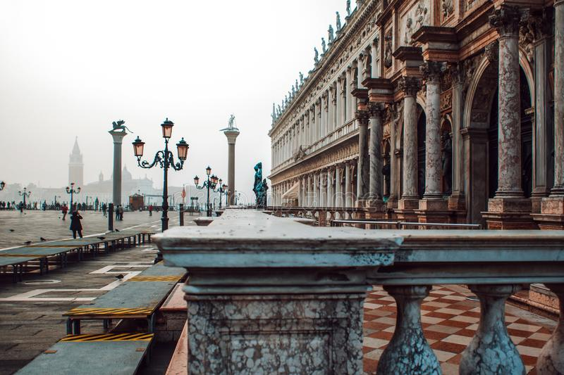 Venice, view of Piazza San Marco, a lot of tourists, fog. Venice, view of Piazza San Marco, lot of tourists, fog royalty free stock images