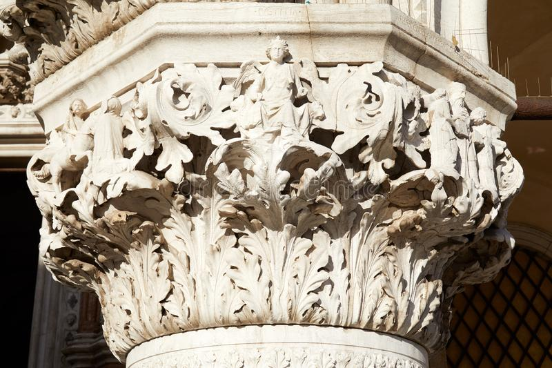 Venice, white capital sculpture with angel and characters in Italy. Venice, white capital sculpture with angel and characters of Doge palace in a sunny day in royalty free stock photography