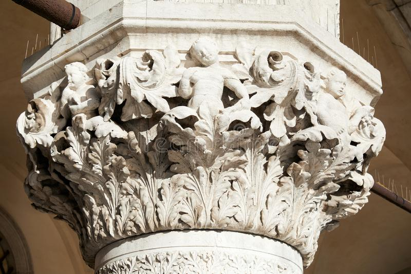 Venice, white capital sculpture with cherubs of Doge palace in Italy. Venice, white capital sculpture with cherubs of Doge palace in a sunny day in Italy royalty free stock photo