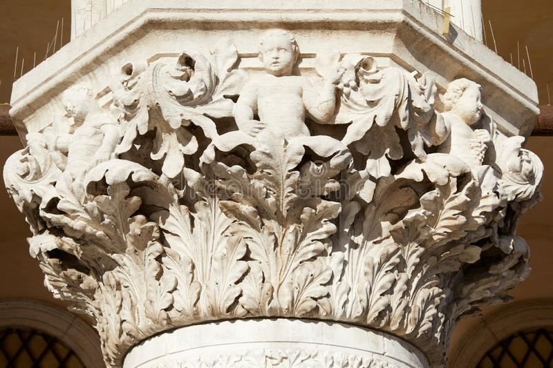 Venice, white capital sculpture of Doge palace in a sunny day. In Italy stock images