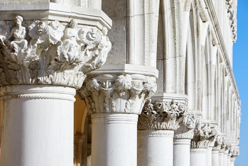 Venice, white capital sculptures of Doge palace colonnade in Italy. Venice, white capital sculptures of Doge palace colonnade in a sunny day in Italy stock images