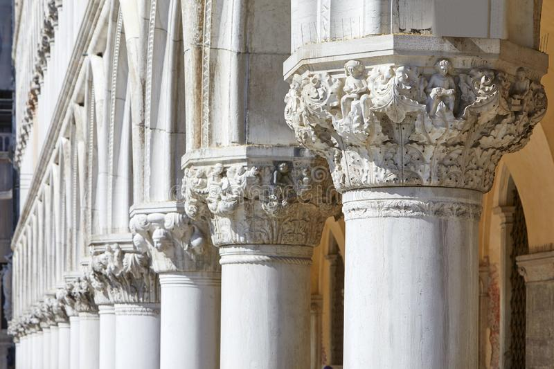 Venice, white capital sculptures of Doge palace colonnade in Italy. Venice, white capital sculptures of Doge palace colonnade in a sunny day in Italy royalty free stock image